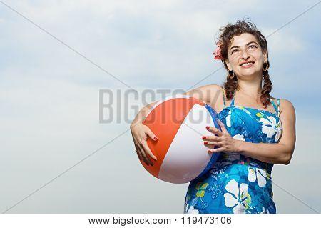 Woman holding a beachball