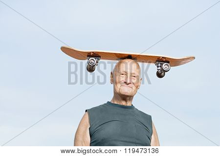 Man with skateboard on his head