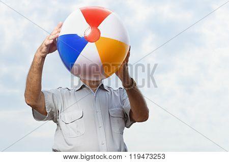 Man holding a beachball