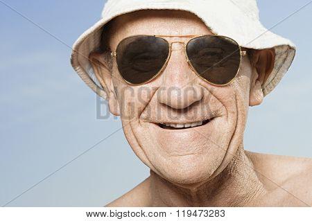 Senior man wearing sunhat and sunglasses