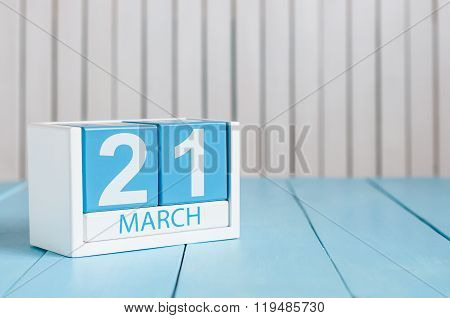March 21st. Image of march 21 wooden color calendar on white background.  Spring day, empty space fo