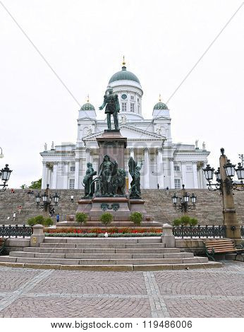 Cathedral Of St. Nicholas (cathedral Basilica) And Monument To Alexander Ii On The Senate Square