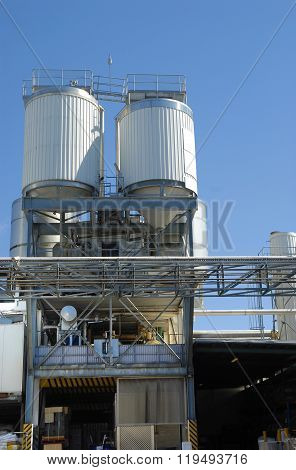 Modern Factory Industrial Plant, Loading Bay And Storage Silos, Vertical