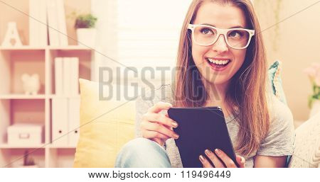 Happy Young Woman Reading An E-book