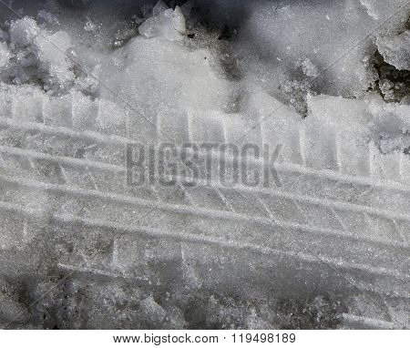 Wet Snow With Tire Tracks. Natural Background.