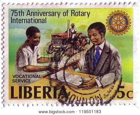 Liberia - Circa 1979: Stamp Printed By Liberia, Shows Rotary Emblem And Vocational Services, Circa 1