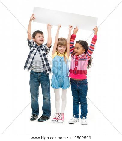 three children with open mouths holding empty sheet of paper isolated on white background