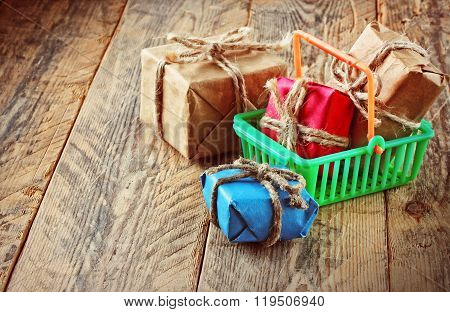 Gift Boxes In Plastic Shopping Basket
