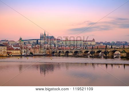 View Of Prague Castle And Charles Bridge At Colorful Sunrise
