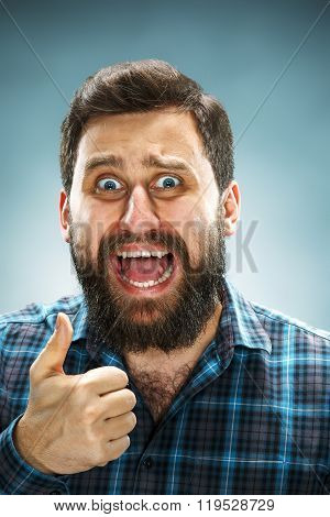 Closeup headshot portrait, happy handsome business man in blue shirt