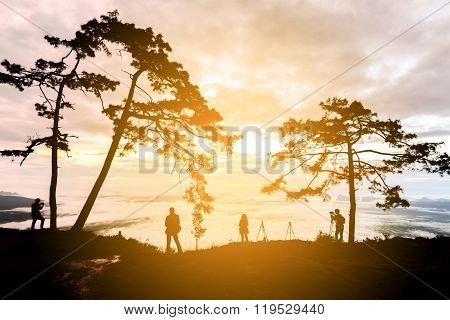 Silhouette Of Photographers Waiting For Looking Mist And Sunrise At Phu Kradueng National Park, Loei