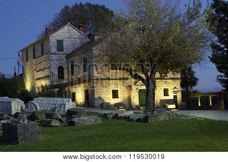 House with old ruins in foreground in Salona, Croatia.