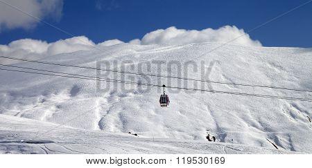 Panoramic View On Gondola Lift And Ski Slope At Sun Day