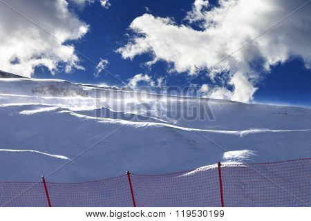 Off-piste Slope During A Blizzard And Sunlight Blue Sky