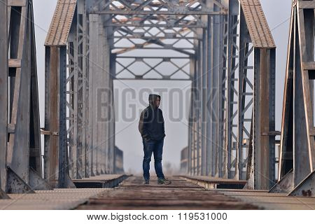 Sad Teenager In Depression Sitting On The Bridge At The Sunset. Concept .teenage Problems. Selective