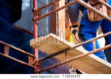 Construction worker insulating house with glass wool, close up