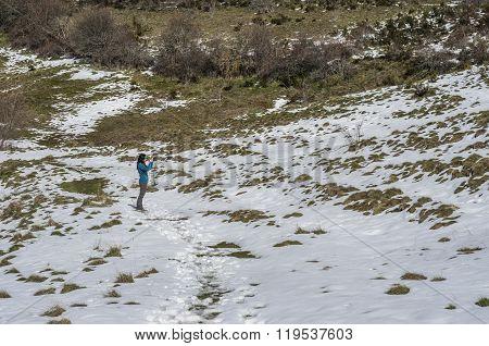 Woman Trekking In Winter Mountains.