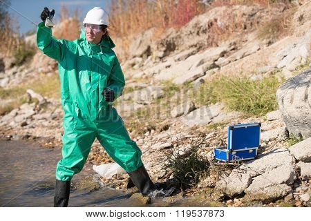 Environmentalist Holding Sample Of Polluted Water