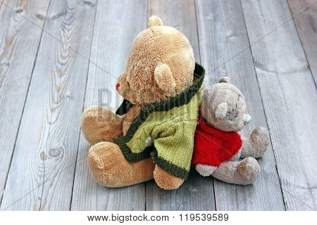 Two Teddy Bear Sitting Backs To Each Other.