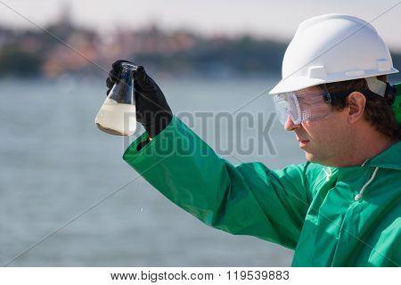 Sample Of Polluted Water In Environmentalist's Hand