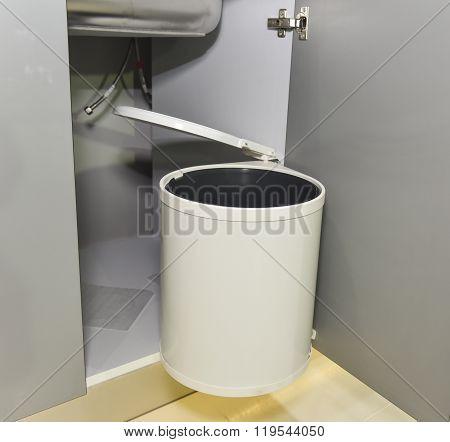 Rubbish Bin Hanging On Kitchen Cupboard Door
