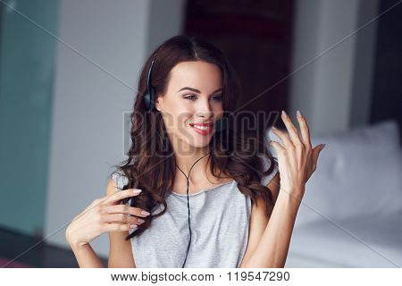Casual brunette woman with headset explain customer support from home online job poster