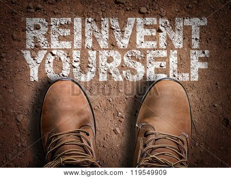 Top View of Boot on the trail with the text: Reinvent Yourself