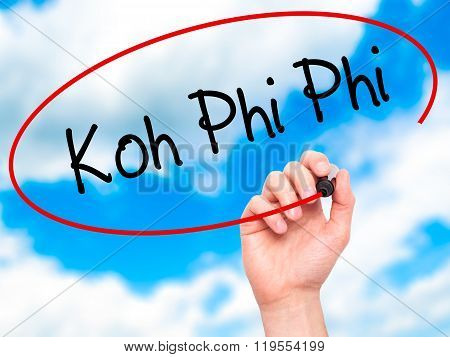 Man Hand Writing Koh Phi Phi With Black Marker On Visual Screen.