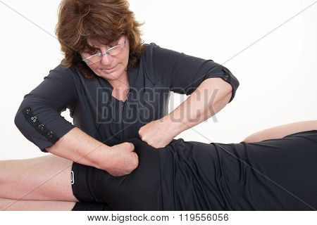 Doctor Massaging The Back Of His Patient While Using Fist