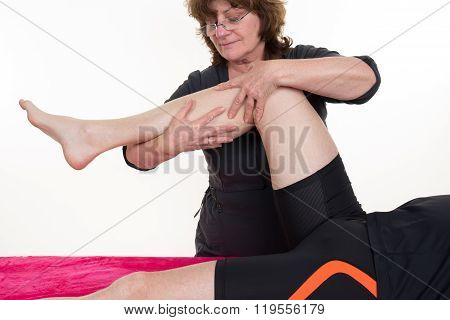 Close-up Of Female Physiotherapist Massaging The  Leg Of Male Patient In A Physio Room.
