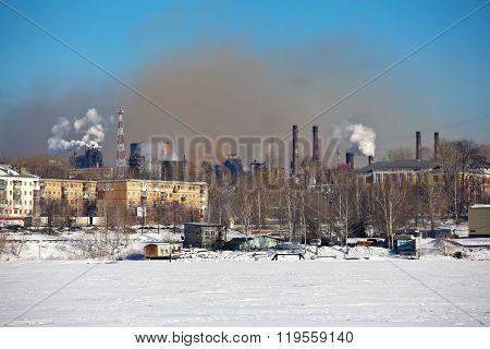 Shimneys Nizhny Tagil Iron and Steel Works (NTMK) in the background of the city. Nizhny Tagil.