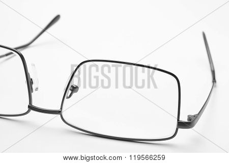 Male Eyeglasses Macro Detail Over A White Background.