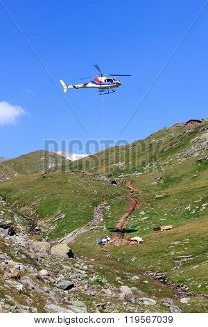 Vertical Replenishment With Flying Helicopter And Mountain Panorama In Hohe Tauern Alps, Austria