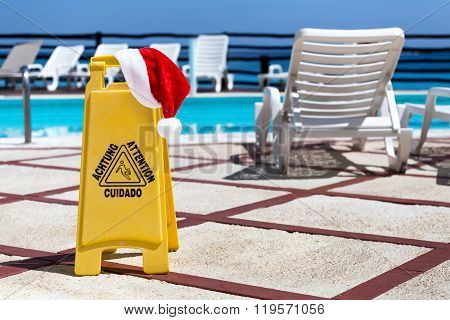 Santa Claus Hat On Slippery Floor Surface Attention Symbol