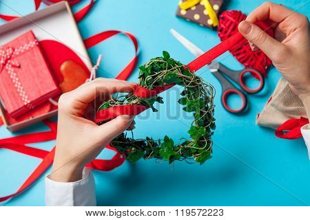 Female Hands Decorating A Gift