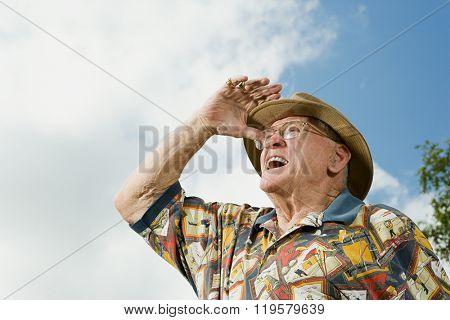 Senior adult man gazing into the distance
