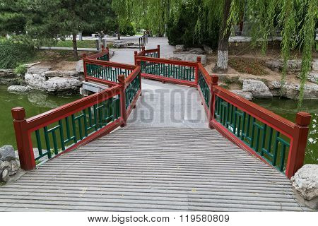Walkway Across The River In Old Traditional Park In Beijing,  China