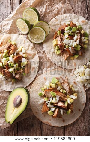 Tortilla With Carnitas, Onions And Avocado Close-up. Vertical Top View