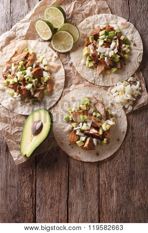Mexican Food: Tortilla With Carnitas, Onions And Avocado. Vertical Top View