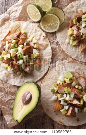 Carnitas Pork With Onion And Avocado On Tortilla Close-up. Vertical Top View