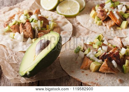 Mexican Tortilla With Carnitas, Onions And Avocado Close-up. Horizontal