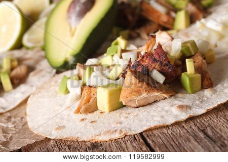 Carnitas Pork With Onion And Avocado On Tortilla Close-up. Horizontal