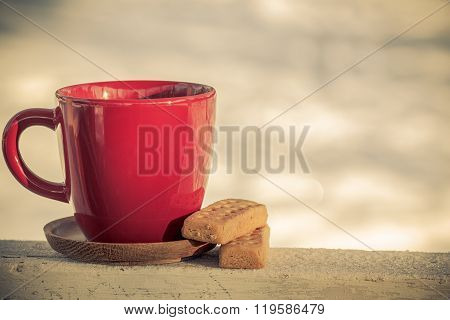 Red coffee cup tea cup with classic shortbread butter cookies on a winter background