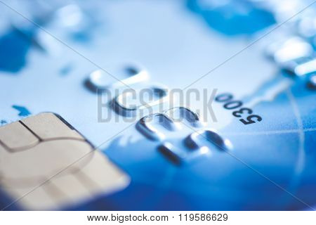 Blue credit card chip blurred with copy space