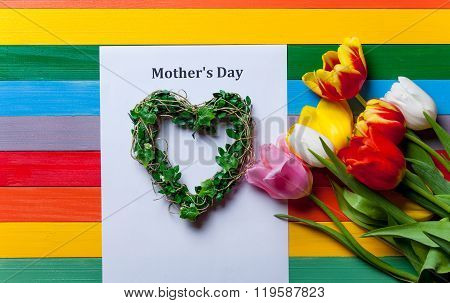 Bunch Of Tulips, Heart-shapped Wreath And Sheet Of The Paper Lying On The Table