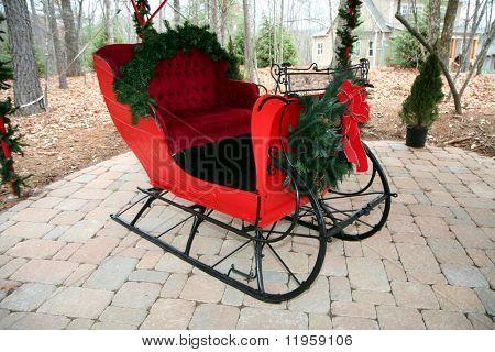 Santas red sleigh parked in a neighborhood