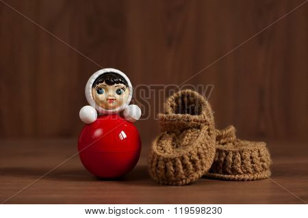 Red Roly-poly Doll And Crochet Baby Booties