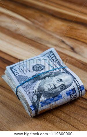 Cash Money Over Wood