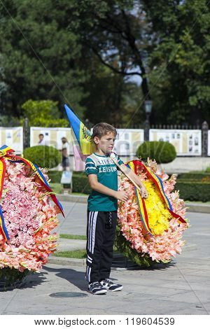 Moldova, Chisinau, the boy at the monument to the flag