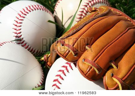 A baseball glove surrounded by balls on a field poster